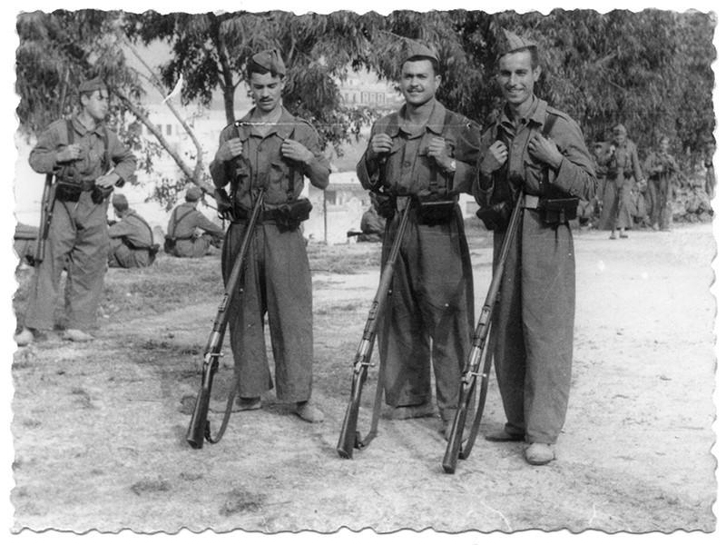 Adolfo Acuña y dos compañeros