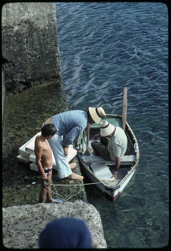 Pescadores en el muelle